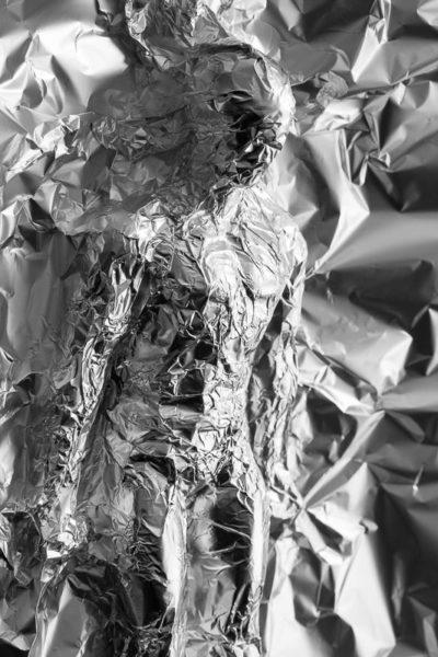 Homme, humanoïde, sculpté dans une feuille d'aluminium